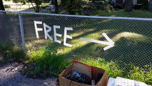 A free sign on the fence.