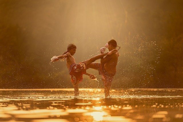 Two children practicing martial arts