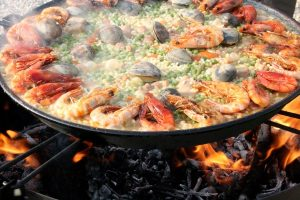A Spanish paella served in a large dish