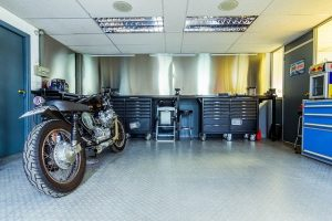 A motorbike in a very neat garage.