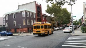 Back view of a typical school bus in Brooklyn.