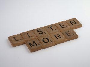 LISTEN MORE written by wooden blocks